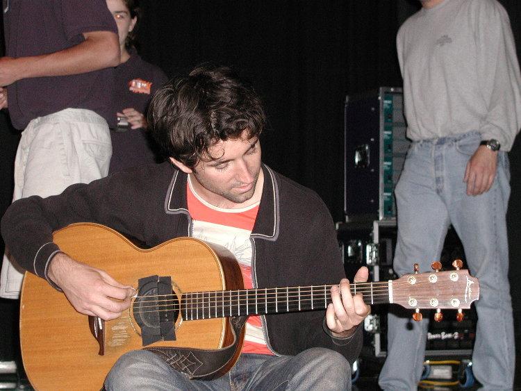 jay playing guitar