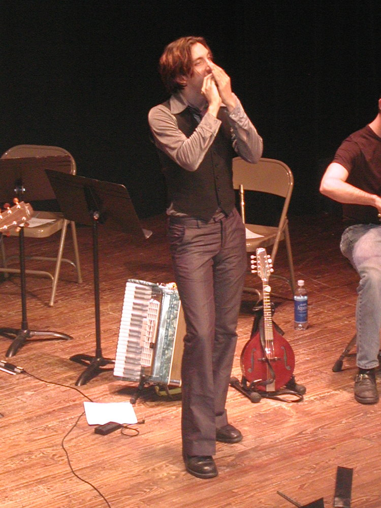 matt playing the harmonica