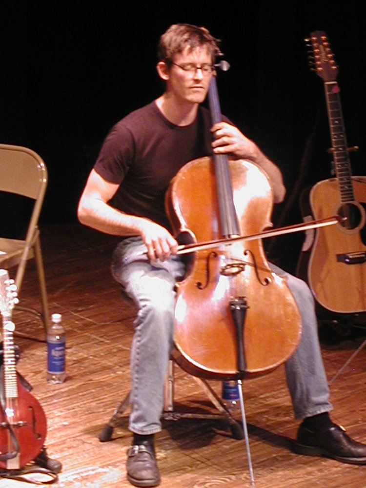 ward playing the cello